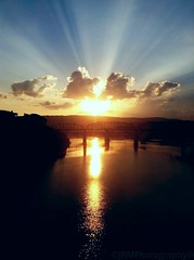 Golden Ray Sunset (edit) (Roland 22) Tags: sunset red orange white reflection chattanooga yellow clouds evening flickr tn tennessee gray bluesky northshore rays walnutstreetbridge edit tennesseeriver goldenraysunset