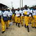 Community Health Volunteers with Ebola prevention kits walking through West Point in Monrovia, Liberia