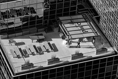 Rooftop Fun_48175-.jpg (Mully410 * Images) Tags: blackandwhite plants minneapolis windows foosballtable reflections skyscraper monochrome idsbuilding woman roof rooftop clc benches pingpongtable building idscenter