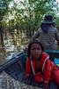Worried looks of Cambodian children (Vagabundina) Tags: nikon d5300 reflections cambodia tonlesap children water lake nature people goldenhour portrait