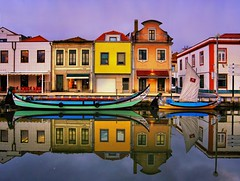 Aveiro is a charming Portuguese town (B℮n) Tags: portugal aveiro moliceiros boat gondel traditionally charm magic hidden gem reflections water canals maritime colour fishermen paintwork azulejo fishing veice lagoon urban festival seaweed tourist holiday vacation pink yellow colors blue round city hopping ornate images man woman clouds weather after rain eusebio picturesque built networks channels jogging runners evening glow sunset 100faves topf100 200faves topf200