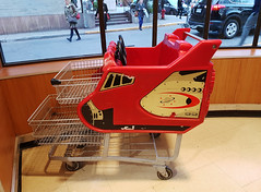 Spaceship Shopping Cart (Exile on Ontario St) Tags: montréal épicerie grocery store supermarket métro grocerystore metro cart shopping panier chariot enfants children child kids rocket spaceship fun window display outside passerby passersby passants passante montreal ndg notredamedegrâce notredamedegrace notre dame grâce grace supermarché emplettes groceries fusée space espace shoppingcart grocerycart