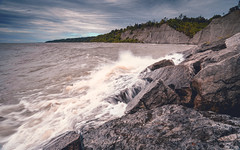 Scarborough Bluffs (kevingomes1) Tags: lenstagger ontario toronto canada sky landscape lake water beach travel stones clouds rough waves outdoor movement rocks weather floating windy scarborough bluffs exploring trees