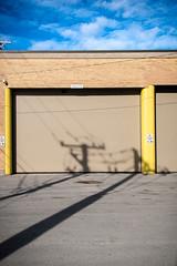(331/366) Pole Shadows (CarusoPhoto) Tags: hd pentaxda l 1850mm f456 dc wr re hdpentaxdal1850mmf456dcwrre pentax ks2 john caruso carusophoto photo day project 365 366 alley garage door shadow sky