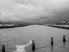 A grey weekend in black & white - Southwold Harbour (3pebbles) Tags: blackandwhite monochrome sea river harbour southwold quay quayside shore water landscape coast rough weather boats boat haven walberswick entrance lifeboat lifeboatstation stormy