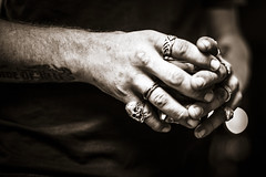 Holding On (Johnny Silvercloud) Tags: bw canon canon5dmarkiii individuals lightroom5 people arms blackwhite blackandwhite detail fingers hands highcontrast monochrome rings sepia shotglass