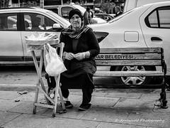 Street 218 (`ARroWCoLT) Tags: wrinkles bnw bnwstreet people streetart istanbul trkiye trkei turkey street sokak samsung photography outdoor siyahbeyaz art bw blackwhite monochrome blackandwhite arrowcolt nx300 oldlady bokeh 30mm f2 sidewalk food streetvendor simiti ishootpeople simit bank bench