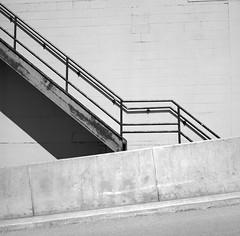 Srairway (geowelch) Tags: thejunction toronto urbanfragments urbanlandscape film 120 6x6 mediumformat kodakportra400bw c41 industrialarchitecture warehouse abstract stairway concrete epsonperfection4870photo yashicamat