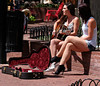Singing in the Street (Colorado Sands) Tags: musicians youngladies babes women female chicas streetmusic singer streetmusicians sandraleidholdt boulder colorado usa singing woman guitar shorts musiciennes