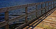 HFF-with dock fence/rail (SCOTTS WORLD) Tags: wood light shadow summer sunlight lake motion water digital fence fun dock midwest angle michigan july adventure orion weathered ripples 248 2014 oaklandcounty lakeorion sooc digitalshot greatlakesstate lakesixteen olympusepm1