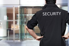 Security guard (findcollections) Tags: people man building male danger person back uniform surveillance duty watching guard police bank security safety professional event staff crime jacket government service agent strength concept protection prevention officer guardian protect bodyguard vigilante safeguard