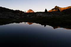 Jon Standing Alone (zh3nya) Tags: sunset mountains reflection water silhouette landscape outdoors washington pond alone hiking kitlens pacificnorthwest wa tarn pnw goldenhour distant northcascades yellowasterbutte 1855mmf3556