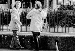 Two women and a fence (pootlepod) Tags: street ladies blackandwhite monochrome fence river photography women couple looking riverside pair railing stphotographia
