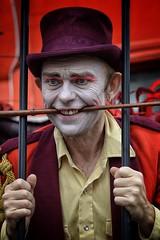 The Caged Ringmaster - EXPLORED (Mazzlo) Tags: uk carnival red portrait nikon colours vibrant caged dslr ringmaster nottinhhill d5100 nikondslrd5100