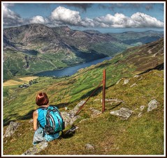 Summer dreaming. (stu.bloggs..Dont do Sundays) Tags: summer cloud lake mountains canon landscape rocks colours lakedistrict sunny cumbria fells views resting 1855mm rucksack lakeland buttermere fencepost missus redpike dalehead highstile tonemapped rockyoutcrops 2500ft