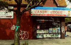 Corner Candy Store (Robert S. Photography) Tags: street nyc boy sun signs colour tree bicycle wall brooklyn corner graffiti candy bodega ribbon grocery canonpowershot 2014 a3400
