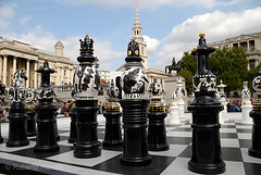 Giant Chess pieces in Trafalgar Square, London, England. The Tournament, an installation created by Spanish designer, Jaime Hayón consists of a gigantic chess set, with 2m high ceramic pieces designed by Hayón on a specially created mosaic glass board. Th (Roberto Herrett) Tags: uk england game london english horizontal set giant pieces board chess trafalgarsquare tournament installation british popular 2009 stockphoto londondesignfestival jaimehayón rherrettflk chessfederation