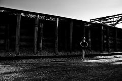 Jen 31 (LongInt57) Tags: girls people bw ballet woman white canada black industry pose nude person grey mono women industrial factory bc dancers modeling okanagan pipes gray models logs teens posing kelowna modelling slippers tutu sawmill woodchips sawdust