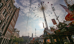 Amsterdam Fair (Andy.Gocher) Tags: andygocher canon100d canon1018mm europe netherlands holland amsterdam looking up wide angle sun clouds