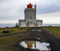 Puddle reflection (katrin glaesmann) Tags: iceland island dyrhlaey lighthouse builtin1927 unterwegsmiticelandtours photographyholidaywithicelandtours vk beach sunset dyrhlaeyjarviti flw10s 1927 coordinates632408n190750w reflection puddle pftze