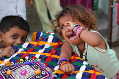 Stranger = Crying or Curious? (Rahul Gaywala) Tags: kutch kutchh vibrant gujarat lrk grk white desert handicraft art india village rural boy girl woman women life colorful vivid tribal colorsofindia greatrunnofkutch eyes expression culture portrait ethnic face travel people