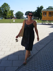 Nina in Vukovar, summer 2016 (sean and nina) Tags: nina vukovar croatia hrvatska balkans balkan europe eu european serb woman female girl lady girlfriend fiancee wife married blue dress summer 2016 brunette dark brown hair long sunglasses candid unposed outdoor outside people person vacation tourist face mouth pink lips throat neck bare skin arms legs tan tanned sunny beauty beautiful gorgeous stunning charming charm happy walking camera path pavement feet sandals shoes white shoulders