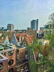 Amsterdam (michalbiernat) Tags: amsterdam city buildings day sunny sun blue sky roofs