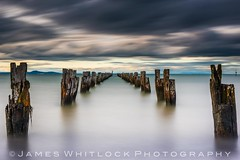 Clifton Springs Jetty (James Whitlock Photography) Tags: australia victoria clifton springs melbourne sunset jetty pier water reflection long exposure wooden post sun colour dilapidated mountain hill motion cloud sky colourful strong lee filters nikon d810