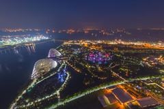 Aerial view of Gardens by the bay by night, a nature park in central Singapore, part of a strategy by the Singapore government to transform Singapore from a Garden City to a City in a Garden. (Bee-Teerapol) Tags: architecture asia bay built city cityscape crossroads culture dark district dome dusk east esplanade evening exterior famous helix hotel illuminated landmark lights marina modern national night opera public reflection river roads roof sea ships singapore singaporean skyline streets styles theater tourism traffic twilight urban view water waterfront nature park