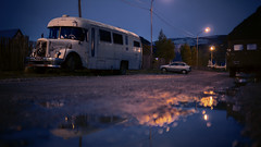 (beetlephoto) Tags: argentina el chalten night dusk twilight street bus reflections puddle lights streetlamps cinema cinematic 169 sony a7r voigtlander 35mm nokton f12
