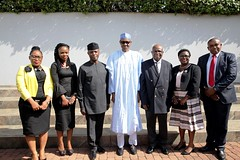 President Buhari and Vice President Yemi Osinbajo in a group photograph with Justice W.S.N. Onnhogen and members of his family shortly after being Sworn-In as the Acting Chief Justice of Nigeria in State House