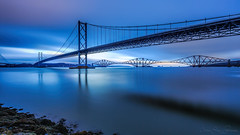 Forth Bridges (MilesGrayPhotography (AnimalsBeforeHumans)) Tags: architecture autumn britain bridge canon 6d canon6d dusk eos ef europe evening f4l firthofforth forthbridge forthroadbridge forthrailbridge railbridge historic harbour iconic landscape longexposure lens le nd nighfall nd1000 nd30 10stopper outdoors old photography southqueensferry reflections rocks river scotland sky town twilight uk unitedkingdom waterscape wide portedgar queensferrycrossing