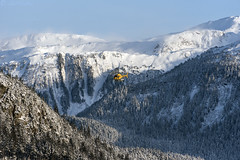 Alaska Coastal Helicopters off on mission 3311 (Gillfoto) Tags: helicopter alaska juneau blue yellow sky snow mountains peaks forest