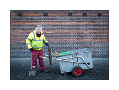 Working Class Hero, North London, England. (Joseph O'Malley64) Tags: roadsweeper roadsweeperscart streetportrait environmentalportrait northlondon london england uk britain british greatbritain portrait wall brickwork bricksmortar pointing vents airvents blockpaving trolley brooms shovel scraper ppe personalprotectiveequipment uniform