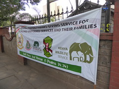 National prayers and thanksgiving (prondis_in_kenya) Tags: kenya nairobi shortrains holyfamily basilica church cathedral catholic uniform uniformedservices thanksgiving notice fence wall