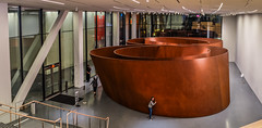richard serra's 'sequence' and unknown teenager (pbo31) Tags: sanfrancisco california nikon d810 color december 2016 boury pbo31 bayarea sanfranciscomuseumofmodernart sfmoma soma city art contemporary modern extention panoramic large stitched panorama night dark sculpture girl window gallery orange