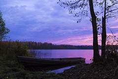 dawn at the lake (markovichsergei) Tags: morning blue autumn lake reflection tree nature water clouds forest ink landscape dawn boat minolta sony magenta belarus colorfulness 1735 f284