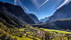 Oetz, Tyrol, Austria (Cristi Pop) Tags: travel blue sky mist mountain green backlight forest landscape austria countryside europe village trails sunny valley contrails tyrol oetz canon6d