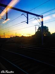 Commuter sunset (Chi Tranter) Tags: light sunset sky sun train tracks commuting