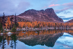 Cathedral Peak Reflection (Don Geyer) Tags: autumn wild usa sunlight mountain lake mountains fall nature water ecology sunshine landscape outside outdoors evening landscapes us washington scenery unitedstates natural outdoor lakes scenic peak sunny falls autumns wa backcountry environment wilderness peaks habitat larch larches scenics evenings ecosystem northcascades environments wilds habitats ecosystems naturalenvironment uncultivated naturalenvironments larixspecies cathedralpeakandfalllarchesabovecathedrallake pasaytonwilderness
