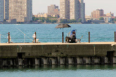 Sittin' On The Dock Of The Bay (PH0T0NAT0R) Tags: summer sun chicago water relax illinois fishing relaxing lakemichigan shore montrosebeach