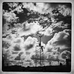 The weight of the world (EXPLORED) (Mister Blur) Tags: sky blackandwhite bw blancoynegro against mxico clouds couple silhouettes yucatn nubes 4s clouded iphone editors mrida explored theweightoftheworld iphoneography hipstamatic