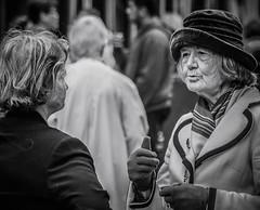 Talking (pootlepod) Tags: street ladies blackandwhite monochrome hat photography women elderly animated talking chatting musing passingtime stphotographia