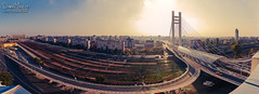 Rooftop panorama (WWPW 2014) (Daniel Mihai) Tags: road street city bridge roof sky panorama sun cars rooftop colors train buildings cityscape streetphotography railway romania rails passage bucharest wwpw wwpw2014