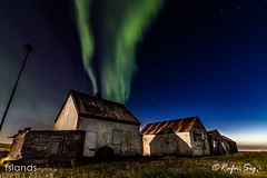 Northern Lights over deserted farm