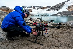 Pilot Phil Tarry flies a DJI S1000 Octocopter Richard Brandon-Cox as the camera operator filming the Defiled in East Greeland. (tommcshanephotography) Tags: music snow cold ice water rock guitar gig band heavymetal greenland fjord iceberg jagermeister thedefiled pirhuk helicoptergirls secretcompass icecoldgig