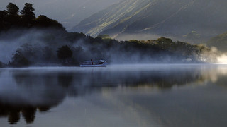 Misty sunrise Padarn lake.