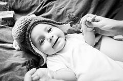 Alek (Dankish) Tags: portrait bw baby white black wool smile hat smiling horizontal canon reflections photography blackwhite kid high eyes hands key mother tokina 1116 60d