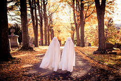 two little ghosts (Kilkennycat) Tags: autumn trees portrait fall cemetery graveyard leaves canon children photography twins child surreal ghosts goldenhour 500d kilkennycat 40mm28 t1i ryanconners