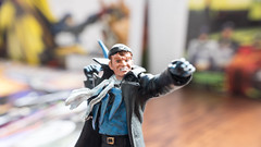 """KL, MALAYSIA – OCTOBER 23, 2014: Slightly defocused and closeup figurine of  Captain Boomerang  (real name George """"Digger"""" Harkness), a violent thug from Australia who uses a variety of high-tech boomerangs to commit crimes and fight the Flash (awiekupo) Tags: city blue man male celebrity standing buildings insect happy comic force power character beefy cartoon fame australian security health disguise captain hero superhero trust strong rogue dccomics cheerful villain success capt darkside boomerang thug enemy nemesis violent bluebeetle jaimereyes bluebody plasmagun bluehero captainboomerang illustrativeeditorial bluefullbodysuit fullbofysuit captboomerang"""